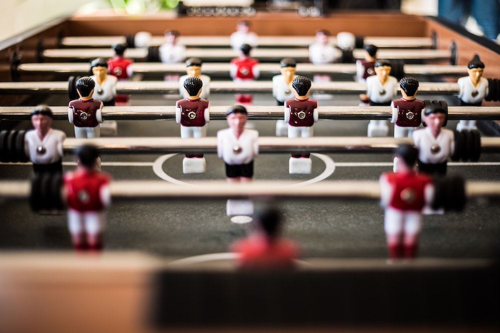 players on a foosball table
